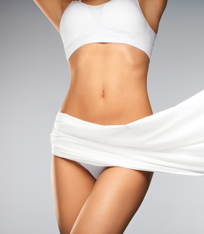 Healthy and slim female body after coolsculpting treatments.