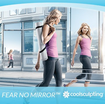 Woman checks herself out in mirror after attending 2016 Coolsculpting Event at Artemedica