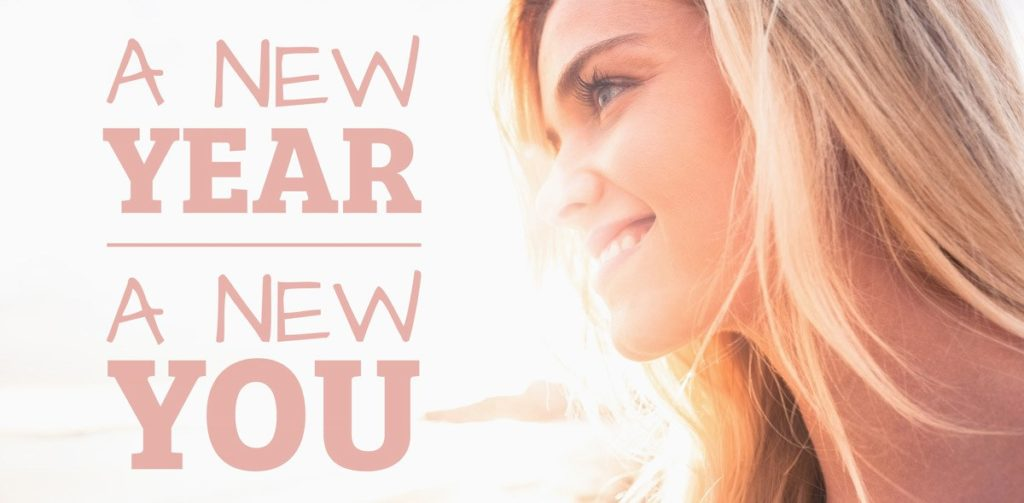 Woman smiling into sunrise. Text reads: New year new you