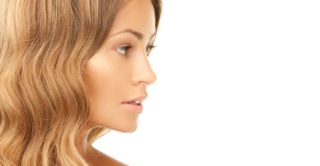 Side profile of woman showing nose.