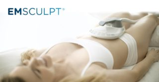 Woman lying down receiving emsculpt treatment.