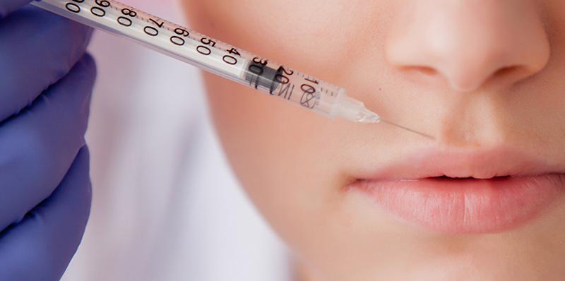 woman receiving botox on her upper lip