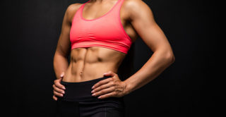 woman's firm and toned abs after receiving cooltone treatment