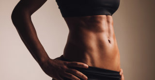 close up of a female body with strong abdominal muscles