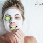 Woman enjoying a mini exfoliating facial from Artemedica at home