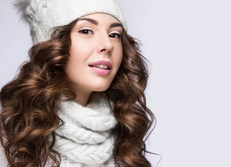Young women dressed in winter clothing with beautiful and flawless skin