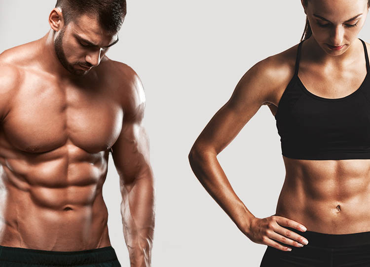 Portrait of sporty young man and woman with muscular body, posing against a gray background