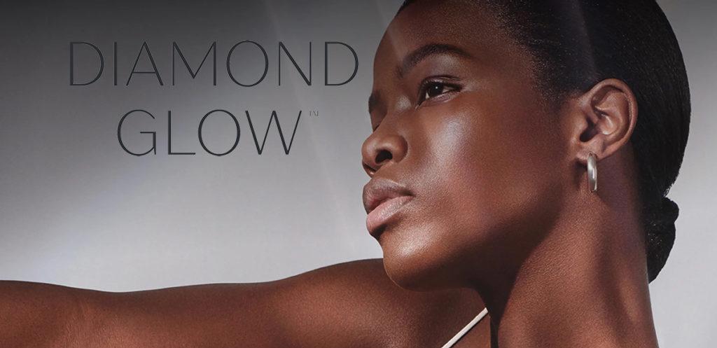 diamond glow logo overlay a beautiful dark skined women with perfect skin